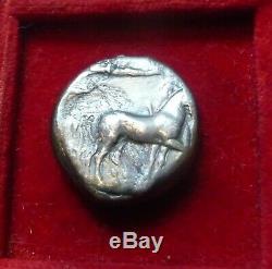 SYRACUSE, SICILY. AR tetradrachm Arethousa dolphins, Charioteer 430 BC. VF